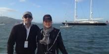 Seth Semilof and Olivia Decker, Larry Ellison's yacht Asahi in the background.