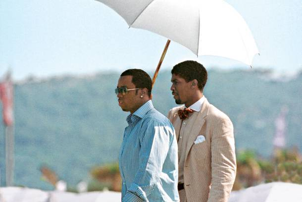 Diddy with his umbrella assistant.