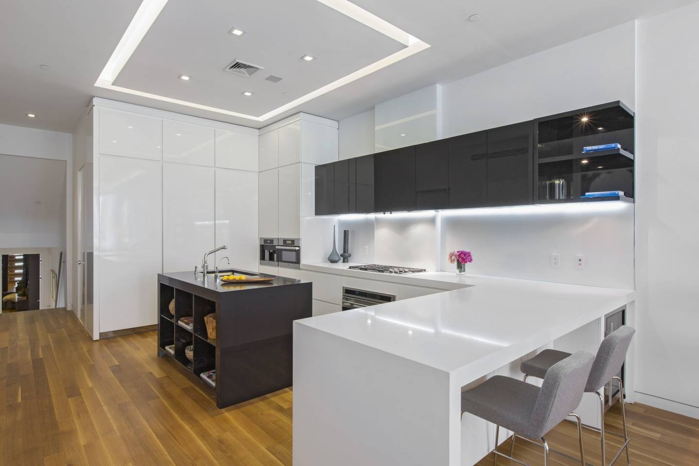 High-gloss cabinetry features built-in appliances.