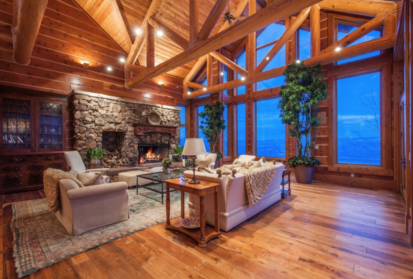 The luxury home features massive wood and stone finishes.