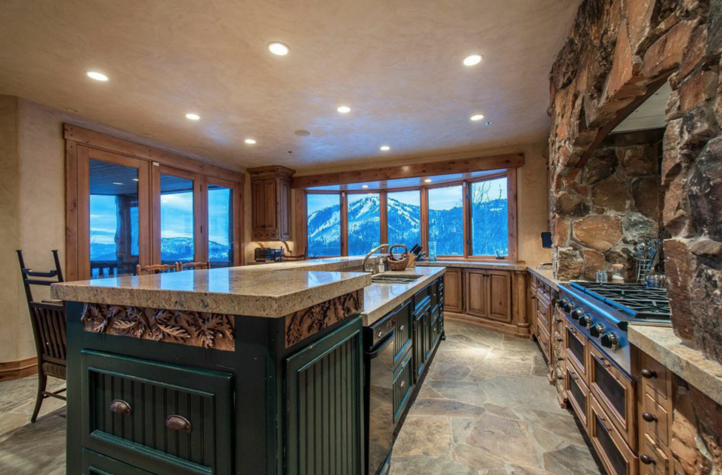 The kitchen has a six-burner stove, an island and a majestic view.