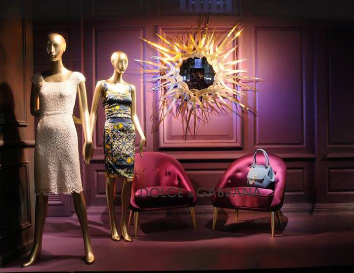 Koket's Guilt mirror and Nessa chairs on display at Saks Fifth Avenue