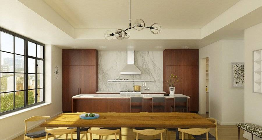 Kitchen featuring Calacatta Gold marble and cabinets made by genuine cabinetmakers.