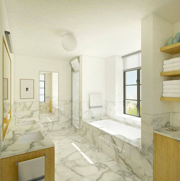 Bathroom crafted of Calacatta Gold marble