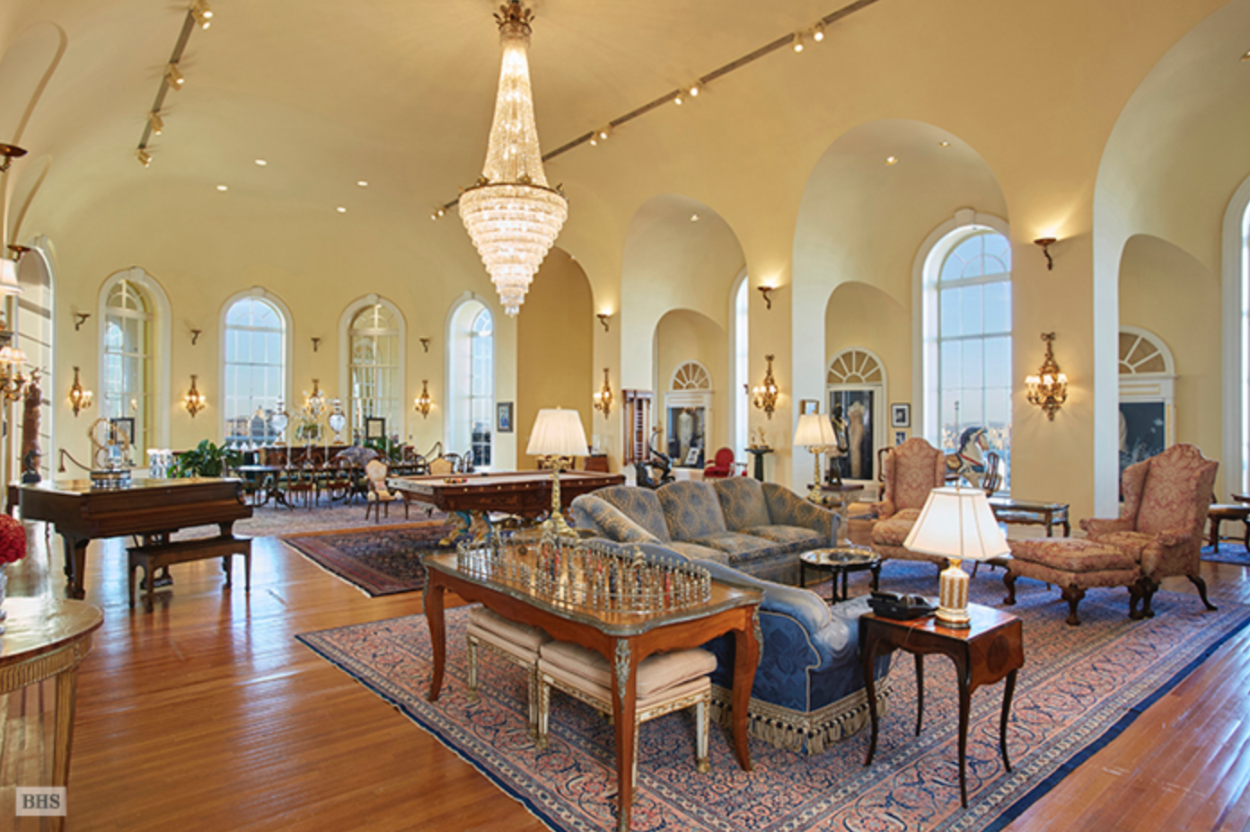 The home's ballroom boasts 23-foot-ceilings, arched window areas and elaborate chandeliers.