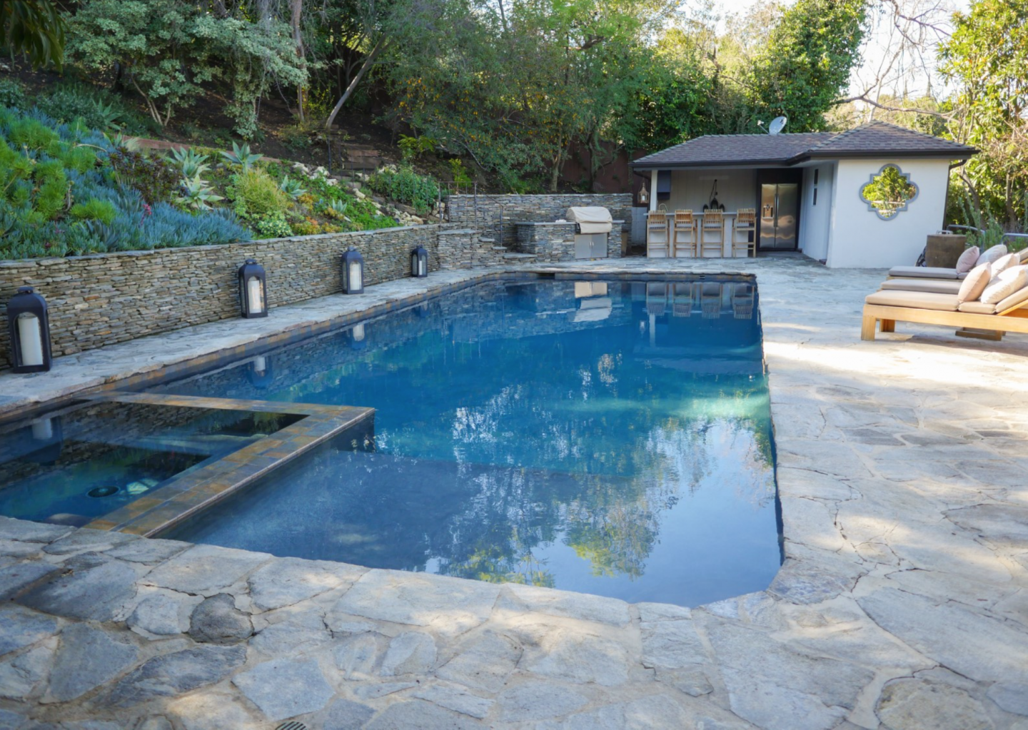 Pool with outdoor shower and changing room