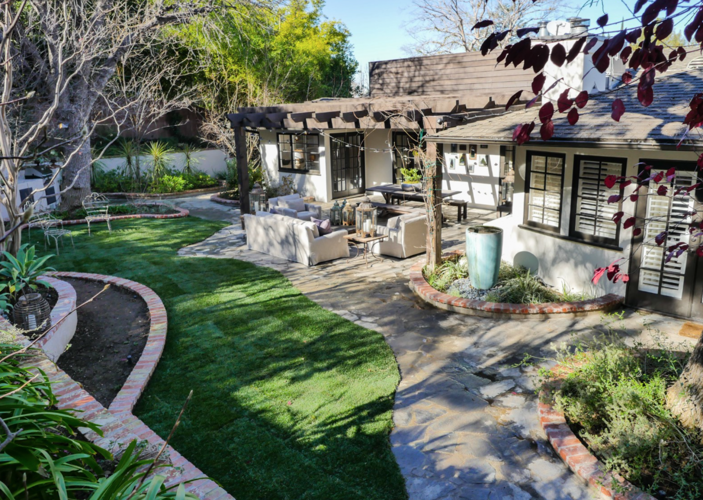 Lushly-tiered backyard creates a private paradise.