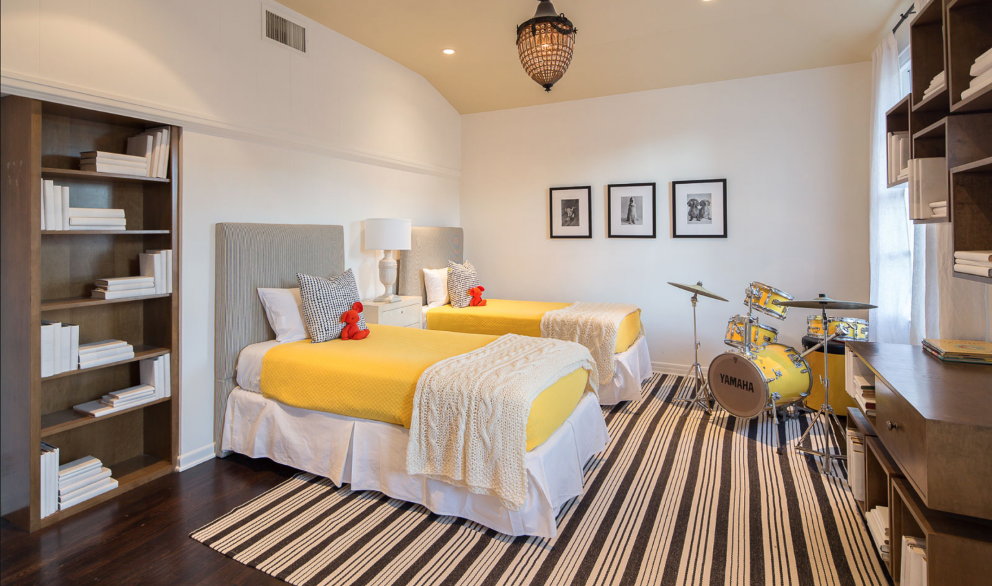 Five bedrooms grace the first floor, including this colorful guest room with matching drums