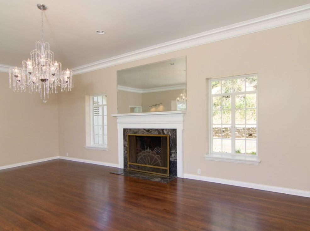 The home has an open layout with espresso-toned floors, fireplaces and ample light.