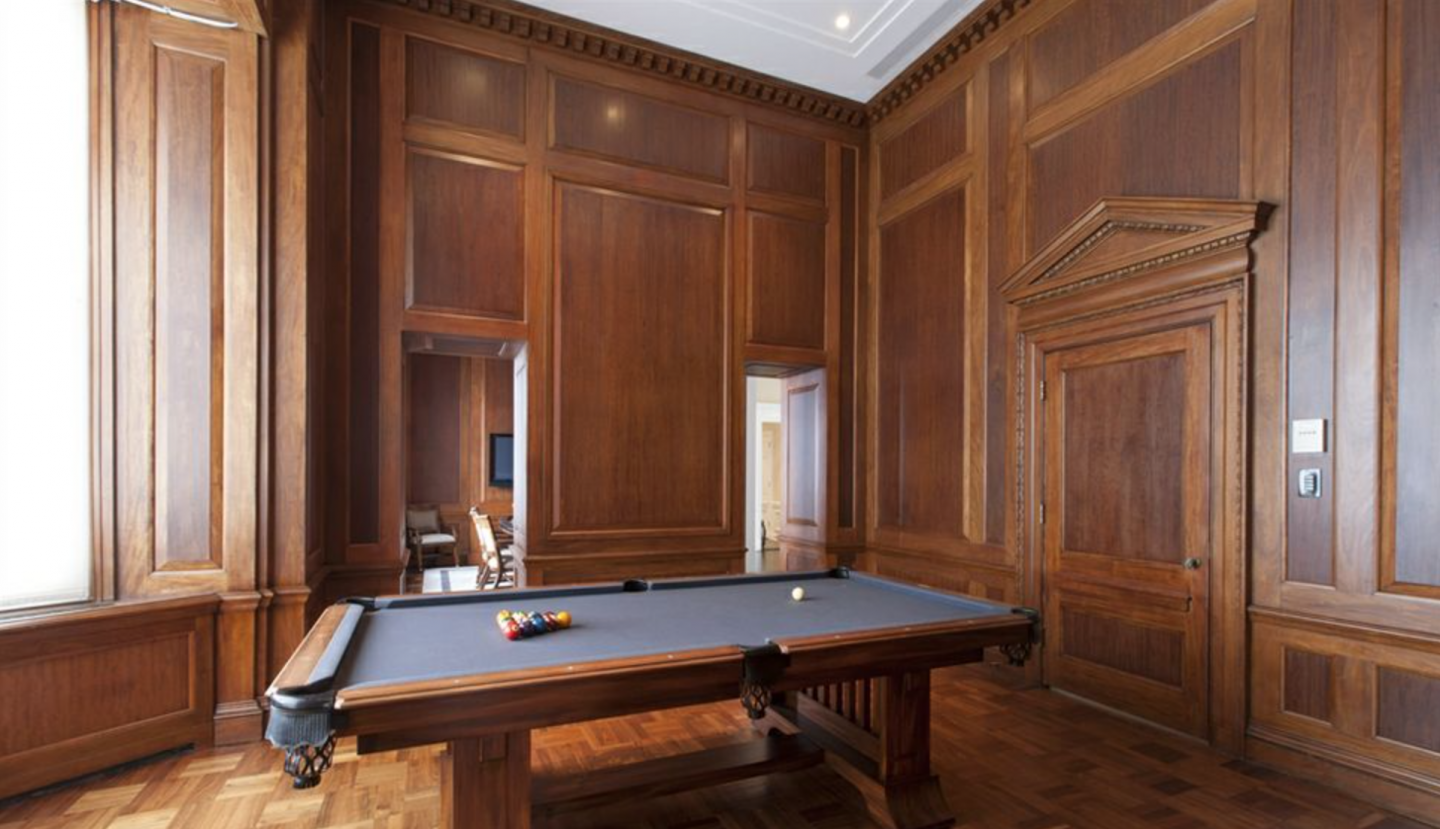 Games are always on in the triplex's top floor. Here is the billiards room.
