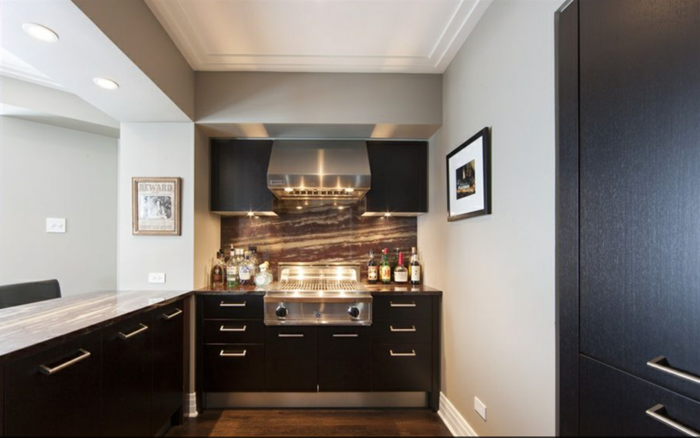 Vaughn's Chicago penthouse features two gourmet kitchens with high-end appliances.