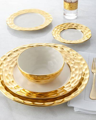 The set ranges from a bread plate of $90 to a charger of $190 and can be purchased at Neiman Marcus. & Set a Gilded Table with These 5 Luxury Dinnerware Sets
