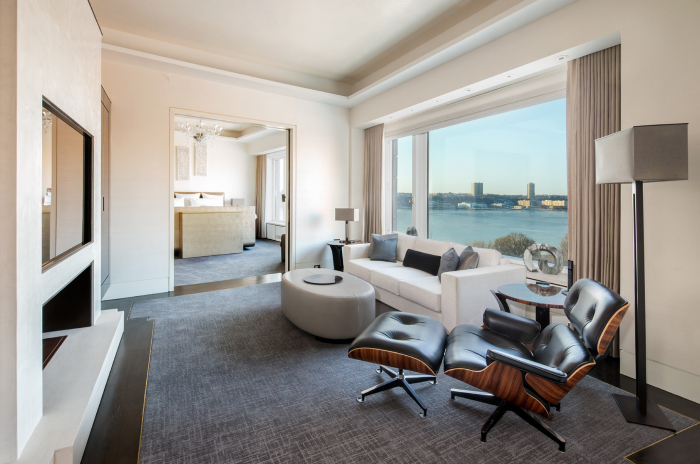 Modern interiors include picturesque panoramic windows, Hudson River views and modern fireplaces.