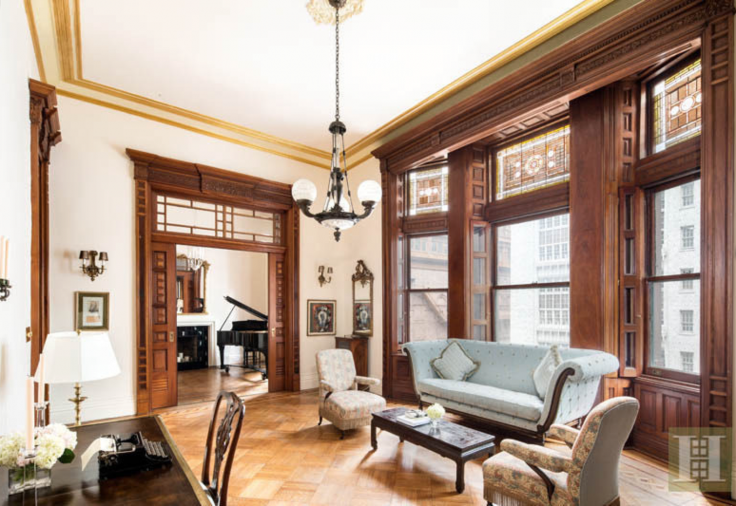 The turn-of-the-century home offers original features such as parquet floors and Bay windows with Tiffany glass transoms.