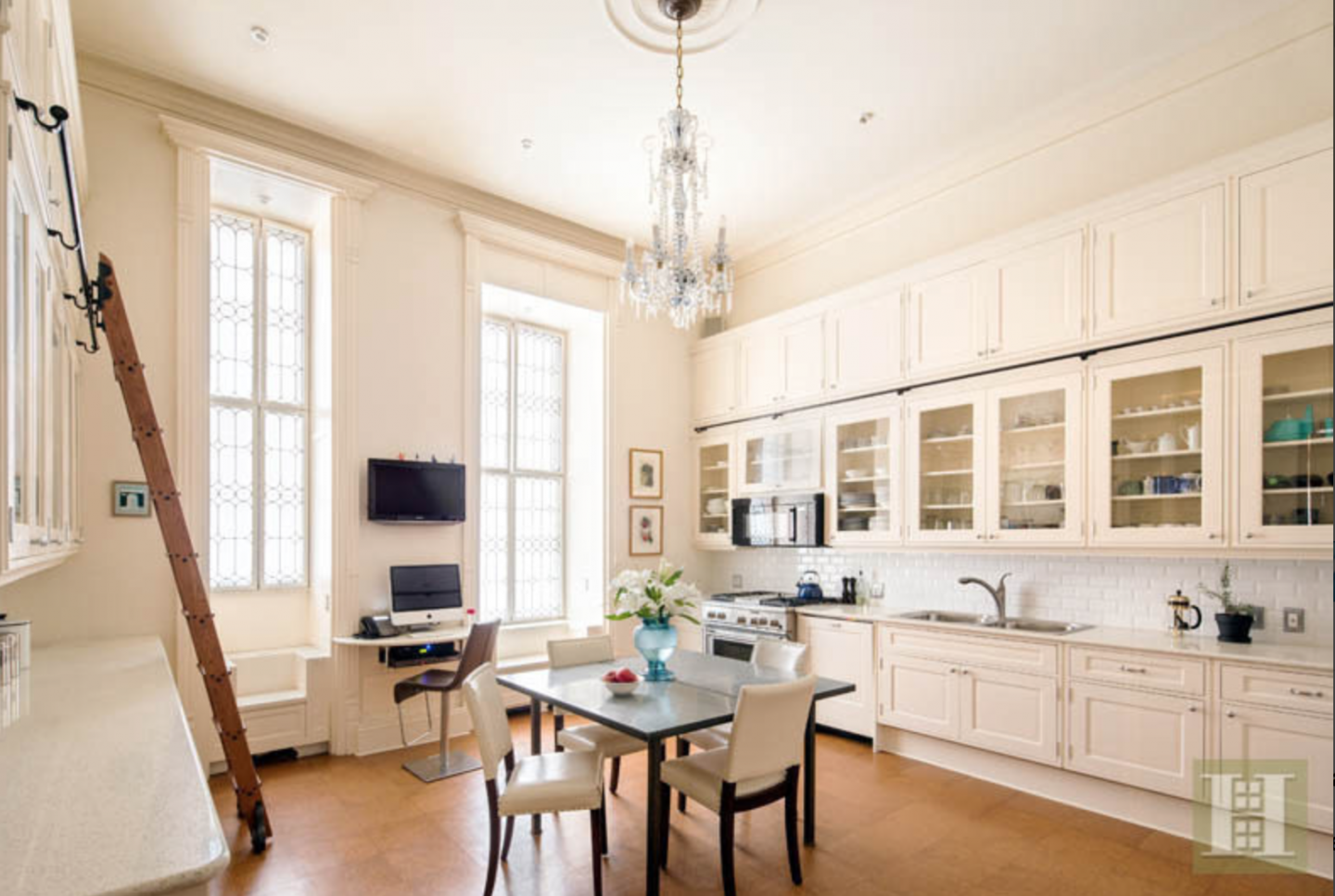 The renovated chef's kitchen, deigned by Françoise Bollack, boasts custom-milled cabinetry.