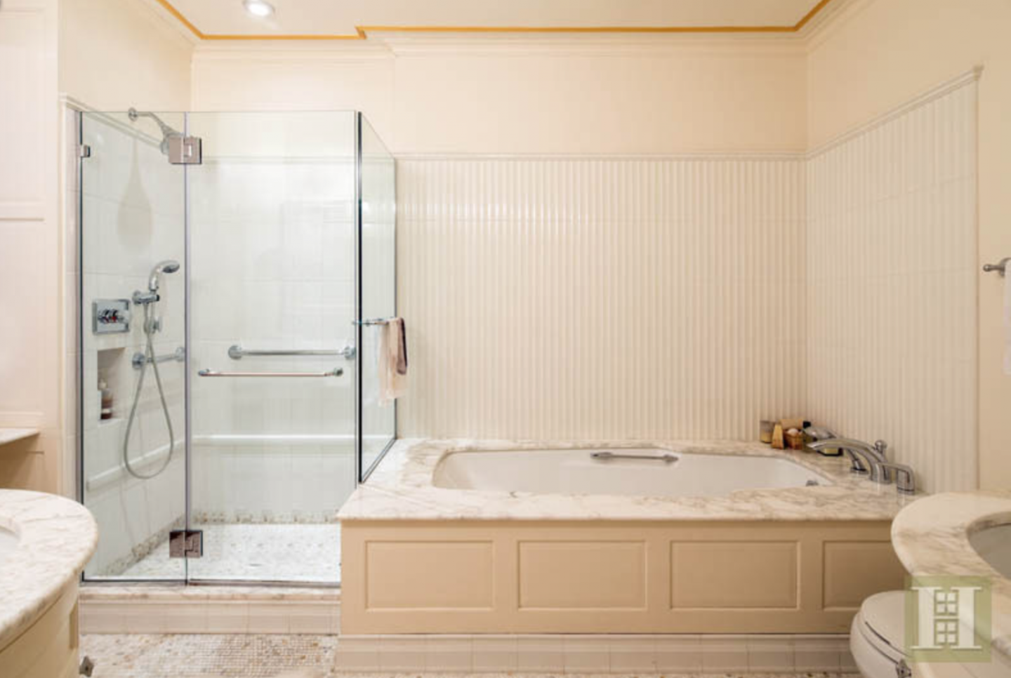 The condo has 3.5 bathrooms, this one with a rain shower and soaking tub.