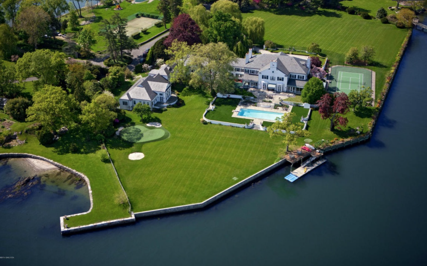Situated on a private peninsula near the tip of Indian Harbor Point, this nearly 20,000-square-foot estate hit the market for $54 million.