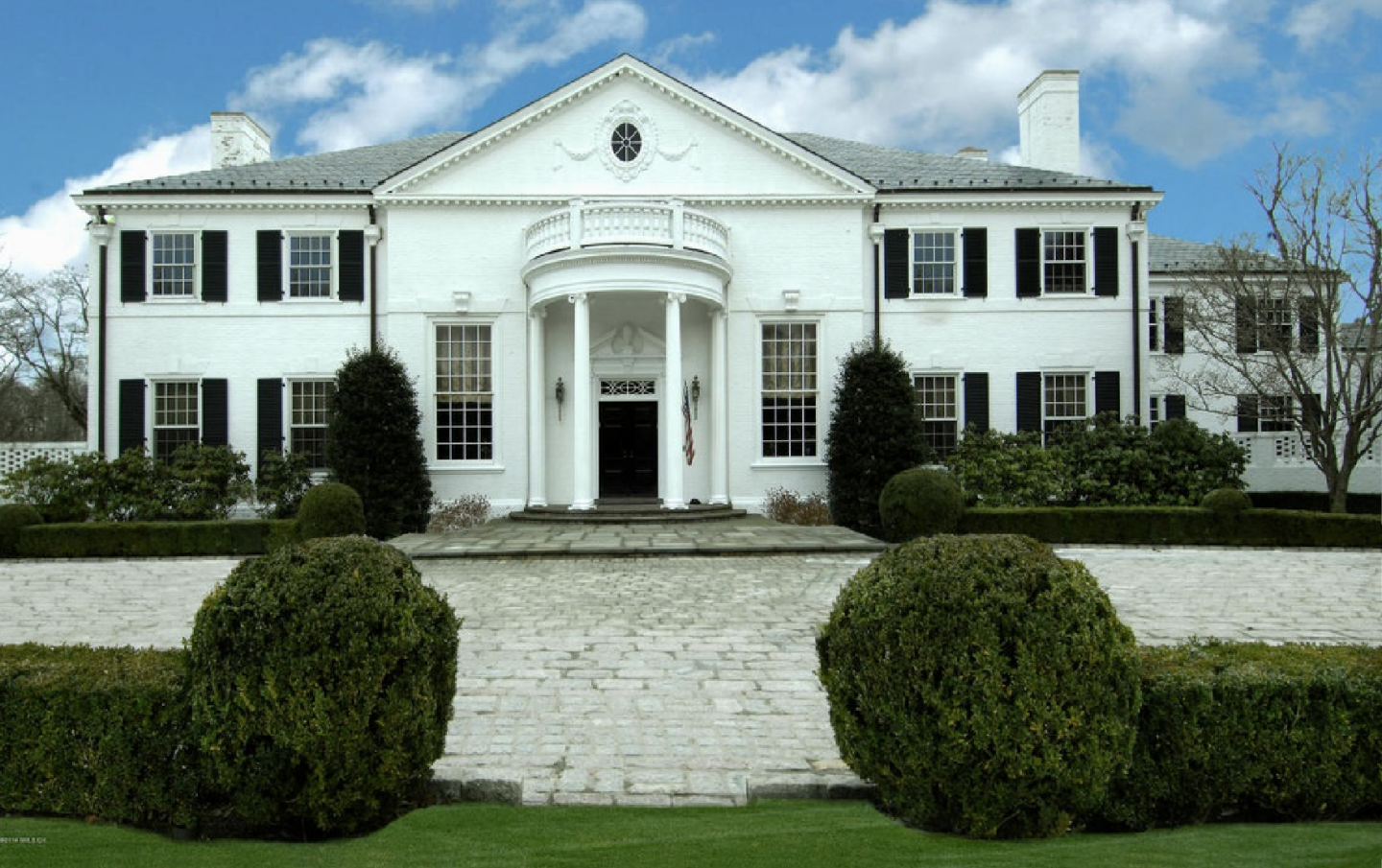 The Colonial property's exterior maintains its original charm, including this portico.