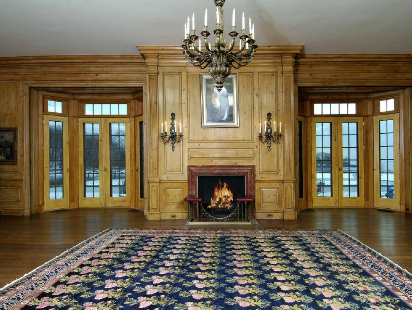 A great room featuring one of countless chandeliers throughout the mansion.