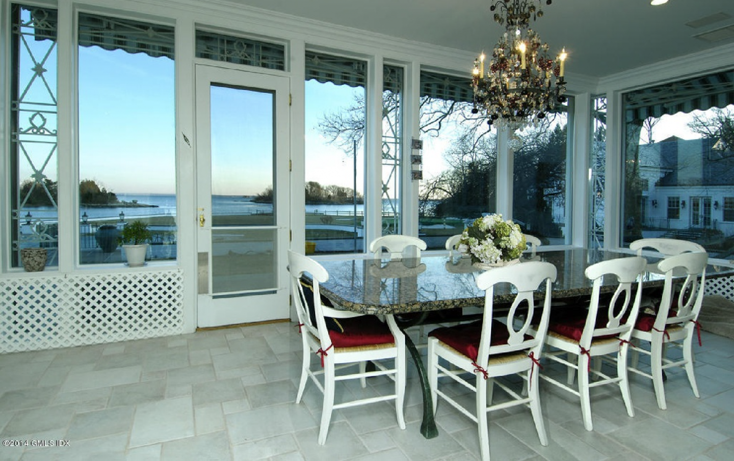 Dining area which looks out onto the pool and Long Island Sound
