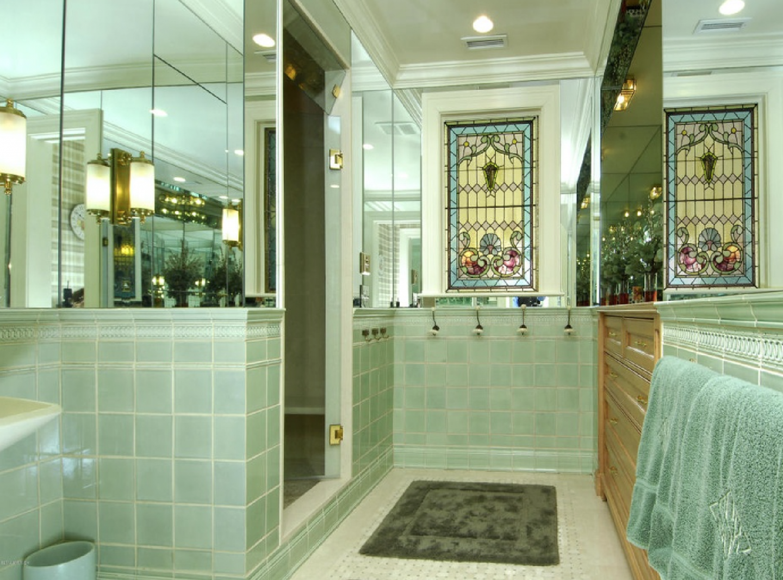 Bathroom with Tiffany glass window