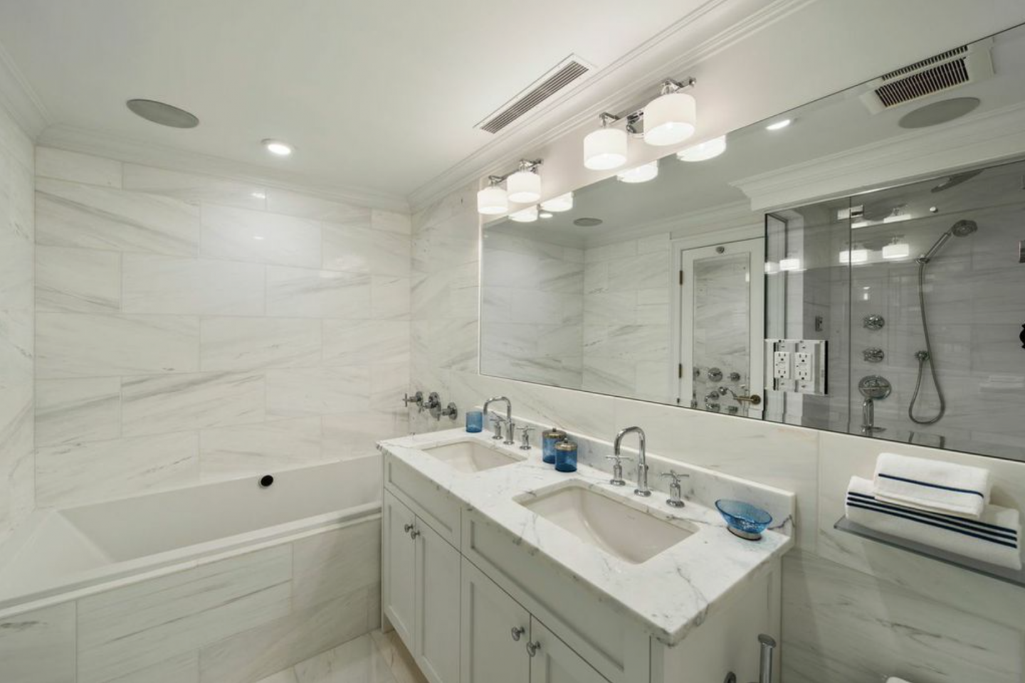 Bathrooms at The Justin boast radiant heat flooring and Bianco Carrara marble.