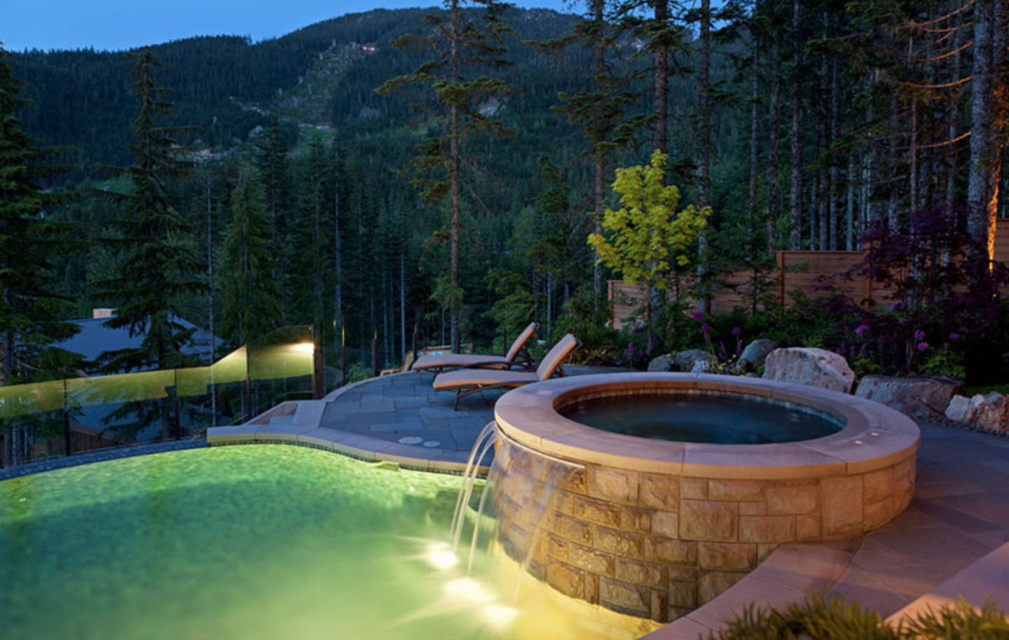 Outdoor hot tub and heated pool.