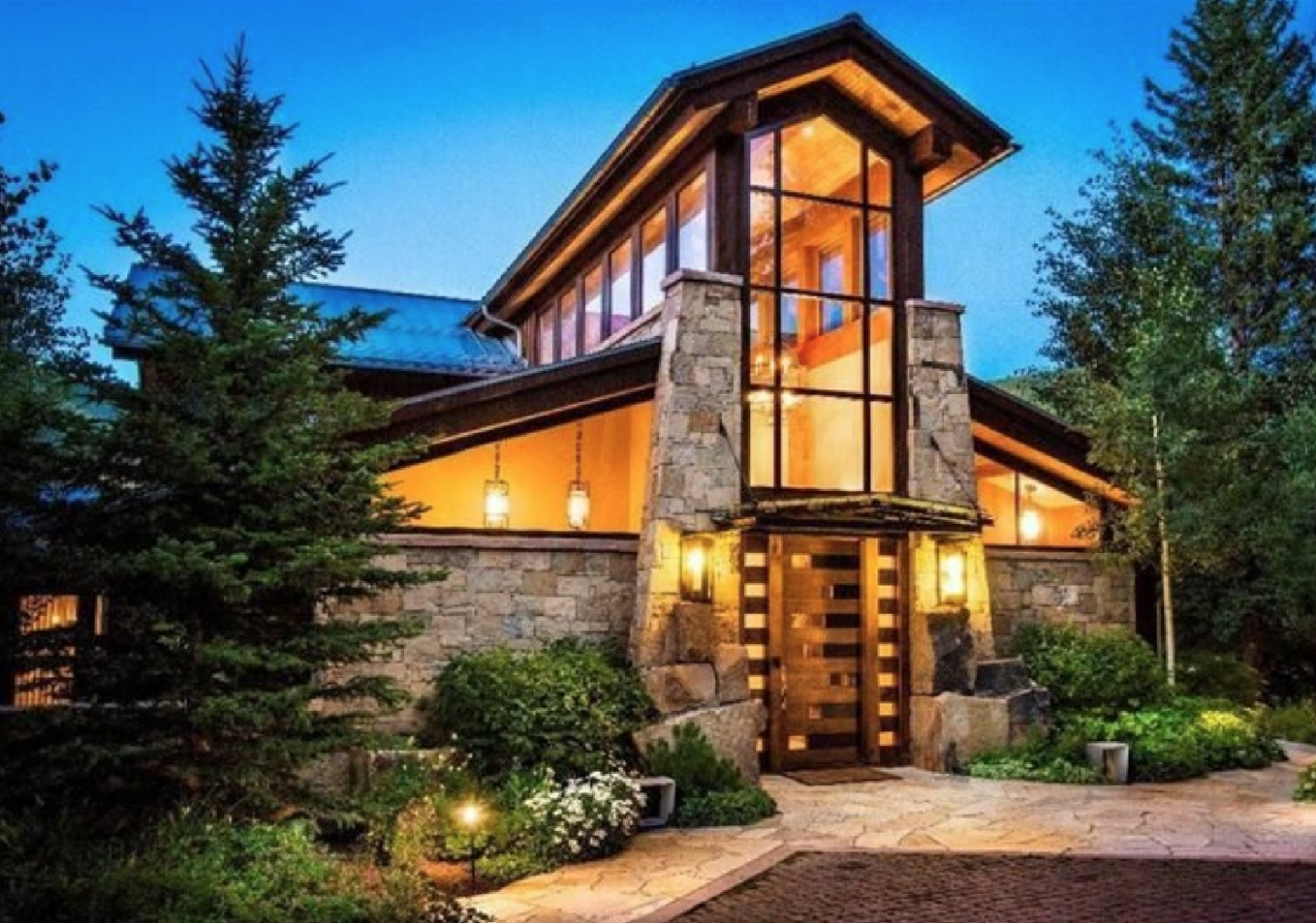 With premium ski access, this stately 11,509-square-foot estate mixes rustic luxury with mountain modern design.