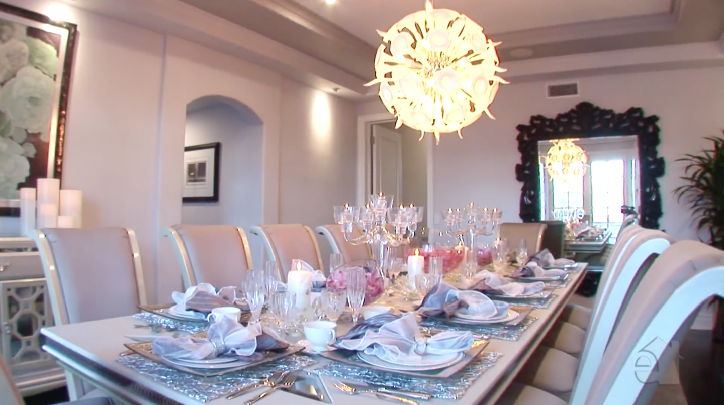 Formal dining area with unique chandelier