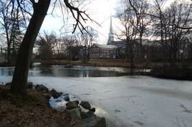 Westfield_New_Jersey_Mindowaskin_park_with_buildings_and_trees_and_frozen_lake