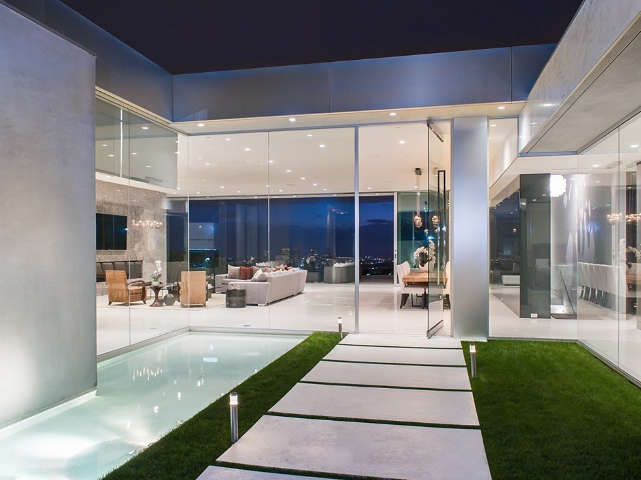 The minimalist mansion with floor-to-ceiling glass walls and manicured lawns can be rented for $150,000 per month.