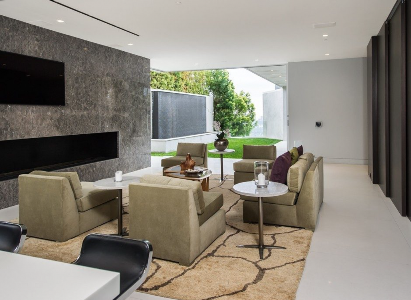 Living space with ample lighting and a modern fireplace