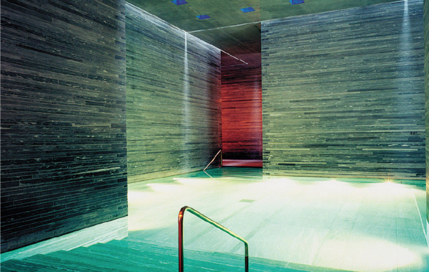 The Therme Vals features meandering light-and-dark labyrinths that flow through various pools.