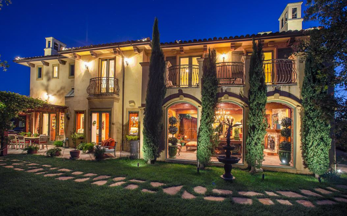 The Tuscan-style villa features five bedrooms and five-and-a-half bathrooms.