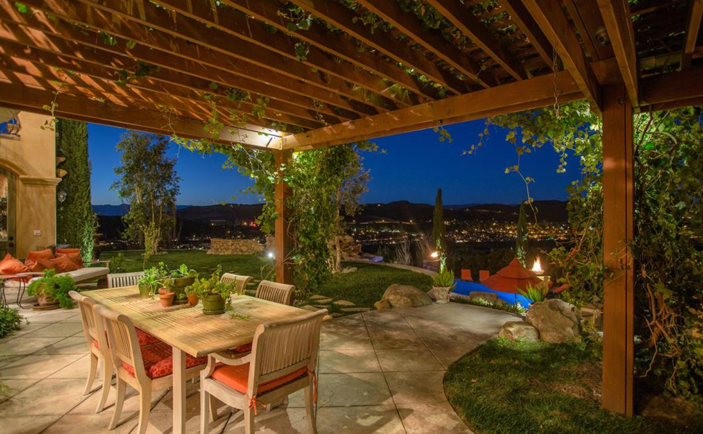 The home is blessed with beautiful grounds, a private lake and this panoramic dining patio.