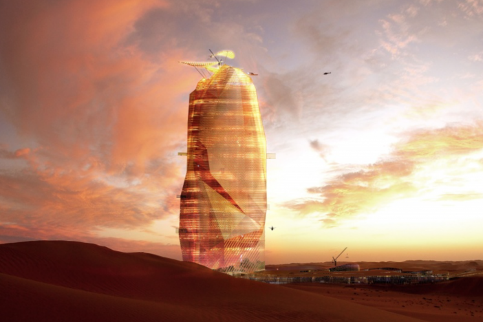 The proposed desert skyscraper illuminates at night.