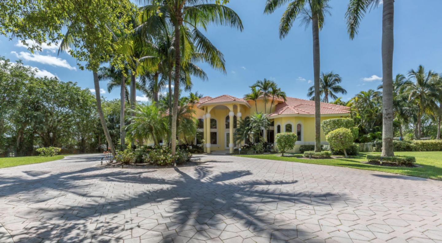 Countless palm trees grace the spacious exterior the 1 acre estate, which is listed for nearly $2 million.