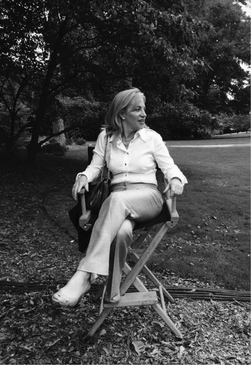 "Debra Johnston sits on set of ""Satisfaction."""