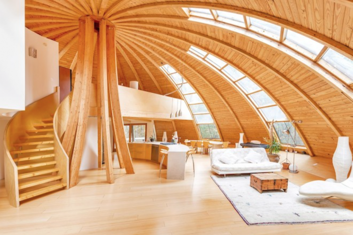 The domed structure allows in ample sunlight via massive windows and lofty ceilings.