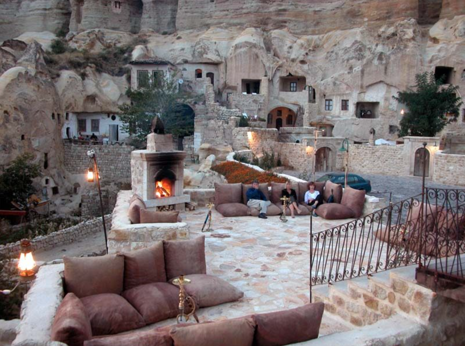Hotel rooms and public spaces are beautified with natural nooks, archways and stone fireplaces.