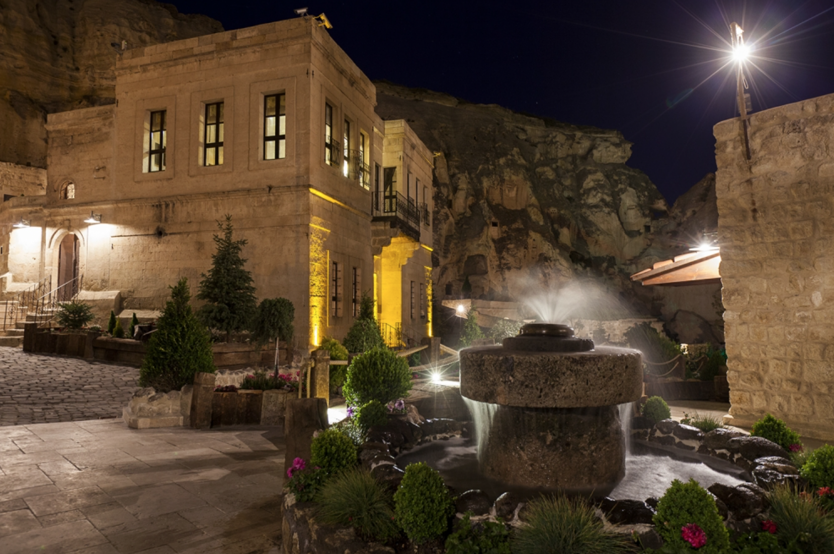 The Yunak Evleri hotel includes the caves and an adjacent 19th century Greek mansion.
