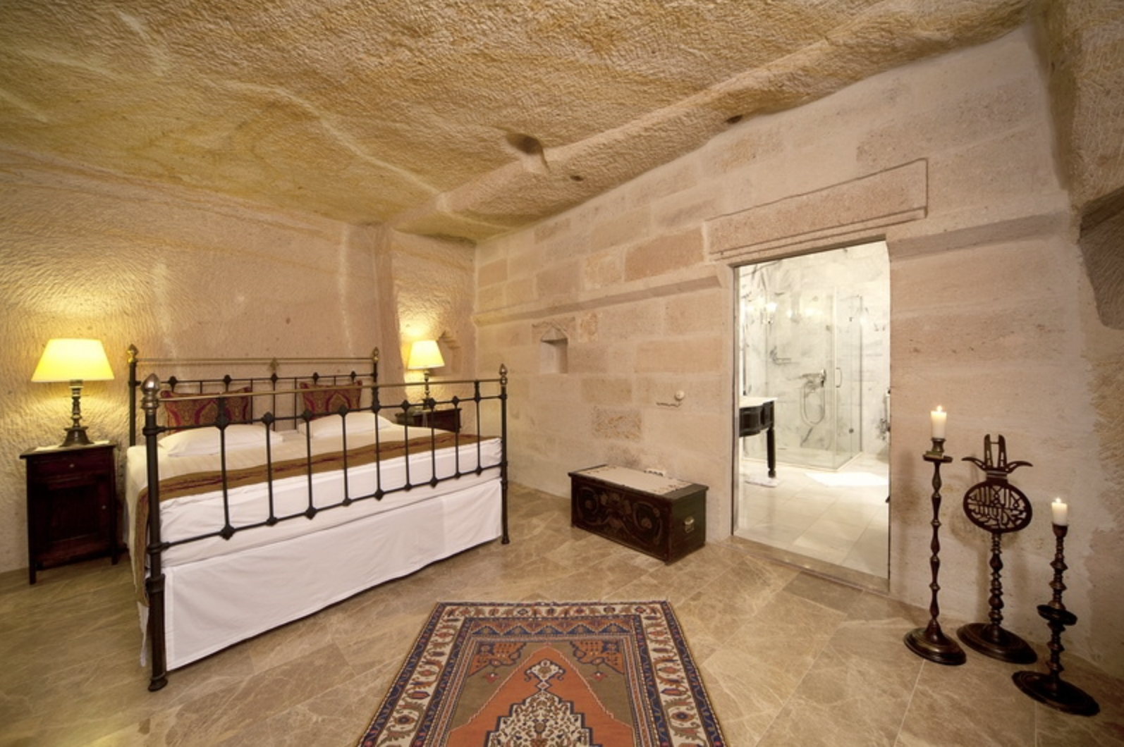 Hotel suites feature  marble floors, hand-laced curtains, antique chests handcrafted writing desks and old kilim carpets.