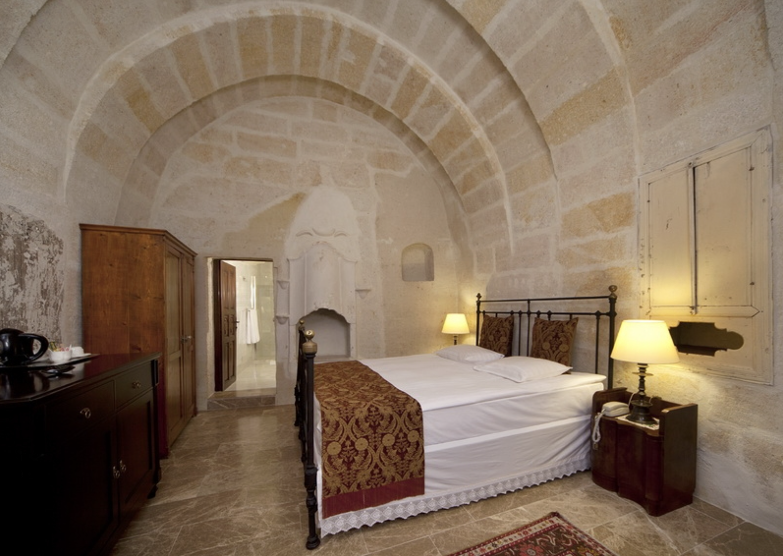 Bedroom suite with high naturally arched marble ceilings.