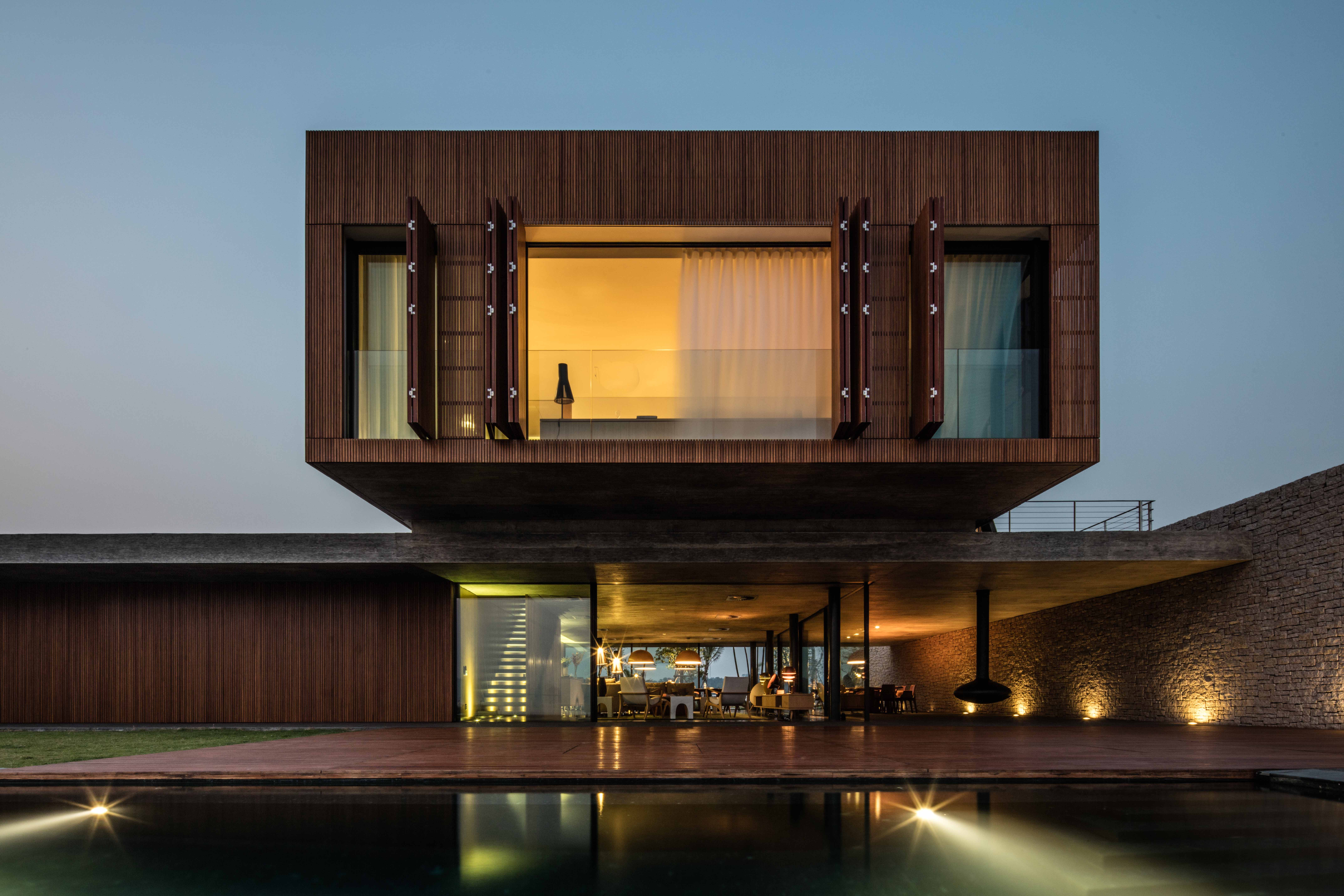 Villas feature cantilevered volumes and flexible living spaces