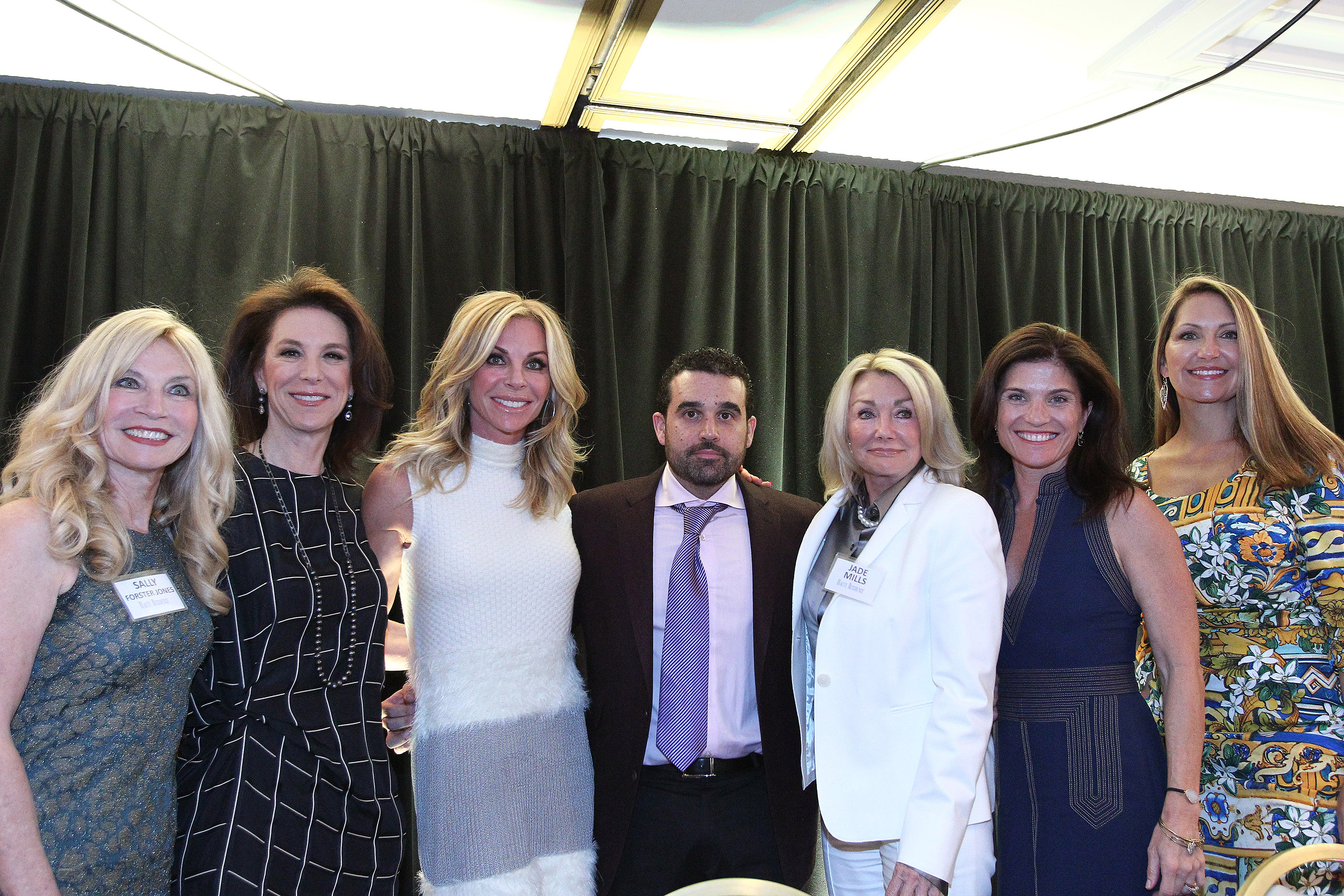 """WEST HOLLYWOOD, CA - MARCH 16:  Publisher of Haute Living & Haute Time Magazine Seth Semilof (C) posese with Cindy Ambuehl, Sally Forster Jones, Jade Mills, Paula Ansara-Wilhelm and Tami Pardee attend the Haute Residence Los Angeles Luxury Real Estate Summit 2016 on March 16, 2016 in West Hollywood, California.  (Photo by Tommaso Boddi/Getty Images for Haute Living)"""