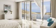 Cliff-top villas overlook the Arabian Sea