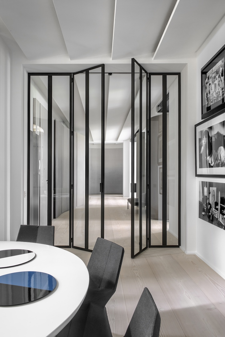 The Trocadero apartment, Paris. Doors in glass and polished steel by Pounat, bronze and corona table by Eric Schmitt, chairs by Konstanin Crcic