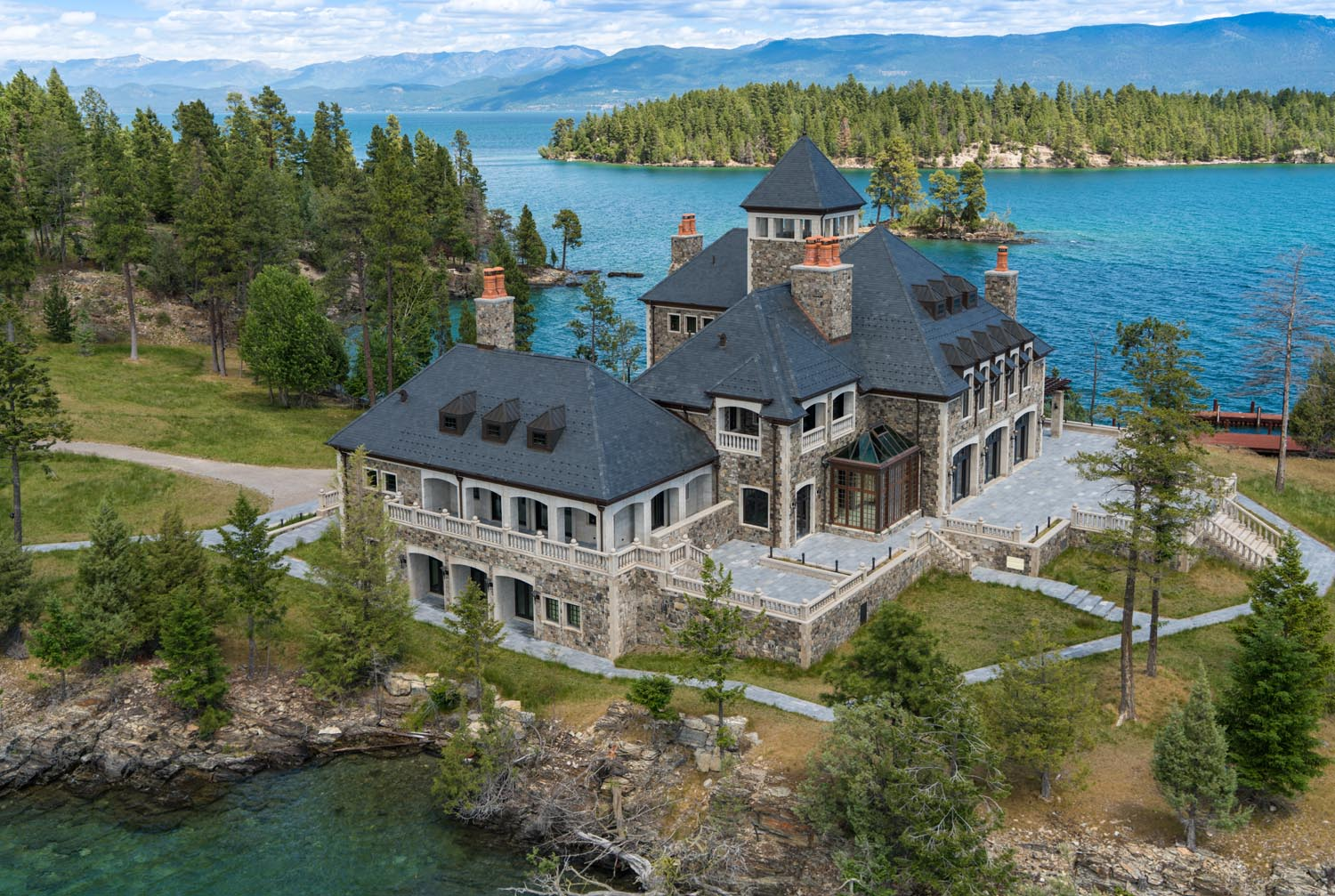 A miniature castle on a private island in montana is Home estate