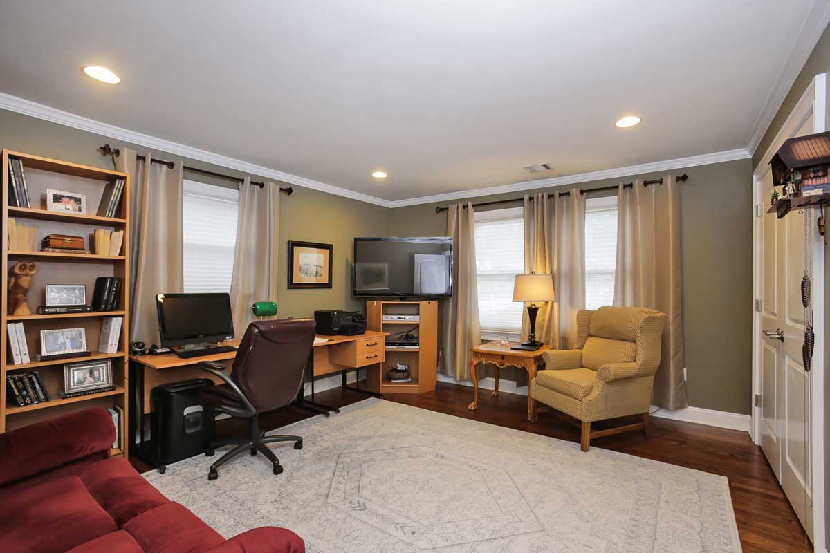 The Ground Level Offers A Family Room With A Cozy Fireplace And A Door  Leading Out To The Patio.