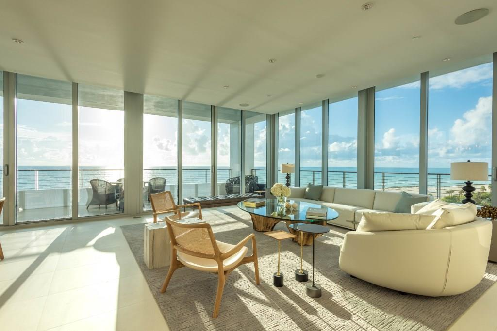 living area with balcony and ocean view